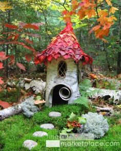 Forest Birch Faerie House by Sally J. Smith -- made of birch bark with autumn leaves for a roof in a deep forest setting