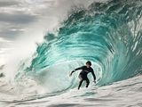 Surfing-I think surfers are cool.  I want to try it.  Just once.  I can guarantee I will be no good at it, I just want to try it!