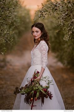 This bride was a knockout in her couture gown, which featured a bodice of scalloped lace and was complemented by a bouquet of jewel-toned flowers. | Photographer: Lad & Lass | Wedding Dress Designer: Robyn Roberts Bridal Wear | Florist: Floral Affairs