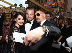 """Perhaps the most important thing to come out of this year's Oscars is a photo of Tom Hardy snapping a selfie with his """"The Revenant"""" co-star, Leonardo DiCaprio, and his wife, Charlotte Riley. If you'll look closely, you can see that Tom Hardy's iPhone case is emblazoned with a photo of himself"""