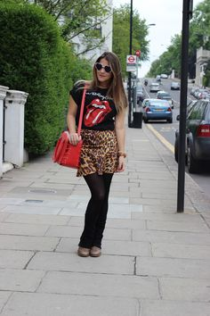 Animal print, rock shirt, heart sunglasses and red bag!
