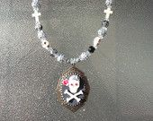 Skull and crossbones with a pink rose necklace