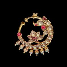 A Gem set Nath Nose Ring Jewelry, Indian Jewelry Earrings, Jewelry Design Earrings, Gold Earrings Designs, Royal Jewelry, Gold Jewellery Design, Nose Rings, Nath Nose Ring, Nose Stud