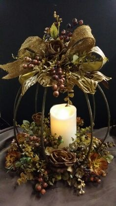 Designer iron pumpkin candle holder designed by Twigs - If you do not want to use a candle, simply tuck in a birds nest to finish the design. Never use a real candle in this type of arrangement. Sold