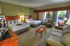 Deluxe Mini Suite - Two Queen Beds, Riverside Private Balcony with a queen sleeper sofa