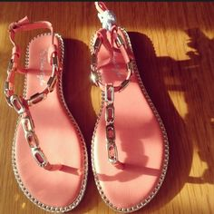 Sandals Brand news sandals never worn. Metal details size 5. Color is like a peach/coral. Shoes Sandals