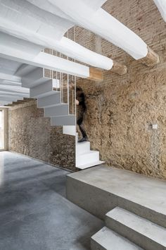 Reform of a House Between Walls is a minimalist interior design project located in Barcelona, Spain, designed by DATAAE.