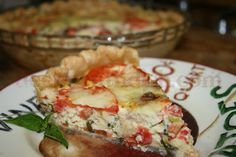 Fresh from the garden tomatoes, fresh basil, freshly grated fresh mozzarella cheese and eggs make up this wonderful summer tomato quiche.