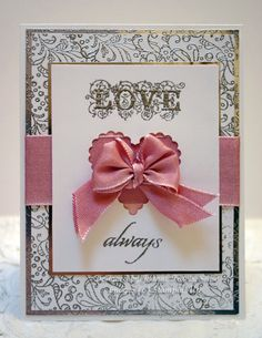 Stampin' Up supplies: Whisper White and Pink Pirouette cardstocks, embossed background in silver using Elegant wheel, Affection Collection sentiments also silver embossed. Pink ribbon is in the new SU mini. Silver metallic cardstock is non SU as is the scallop heart Nestabilities die.