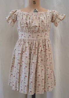 An adorable printed cotton dress made in the US circa 1850.