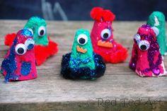 monster finger puppets = egg carton + paint + glitter + pom-poms + google eyes