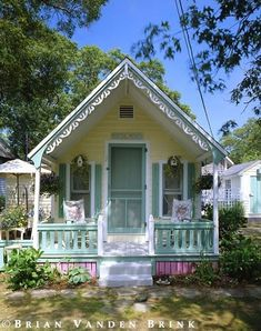 Tiny cottage, and have a look at that gingerbread trim! - Cottage home decor