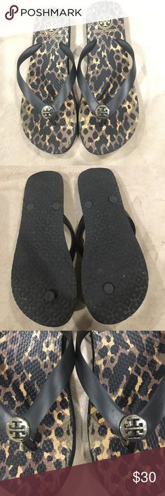 Tory Burch flip flops Almost new Tory Burch leopard print and black strap flip flops with gold tone Tory logo. Tory Burch Shoes Sandals