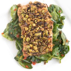 pistachio encrusted salmon  served on a bed of wilted baby spinach tossed with sundried tomato pesto.  (All made using coconut oil)