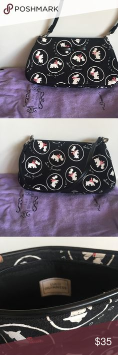 """Lulu Guinness dog print black handbag Lulu Guinness dog print black handbag with black strap. Zipper closure. Super cute London brand! Dust bag included. In near perfect condition, but leather bow on front rolling out a little (see pic).  - 9.5"""" bottom width - 5"""" height  - about 7"""" opening at top Lulu Guinness Bags Mini Bags"""