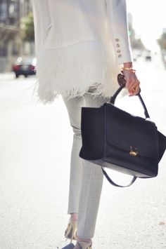 this feather lined blazer paired with gray dress pants is so chic for work
