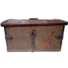 Folky Money Chest with Great Paint Decoration and Iron Work from Norway   From a unique collection of antique and modern painted furniture at https://www.1stdibs.com/furniture/folk-art/painted-furniture/