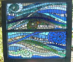 Privacy without curtains: glass-on-glass mosaic.