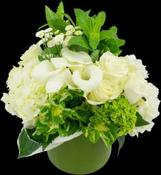 Cream Classic - calla lilies, creamy roses, white hydrangea and fragrant herbal textures, dotted with whimsical feverfew flowers | Winston Flowers
