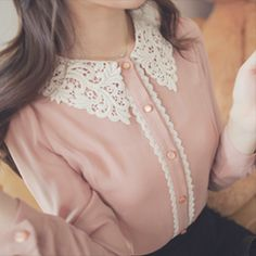 Very cute pastel top with a lace collar and lace detailing