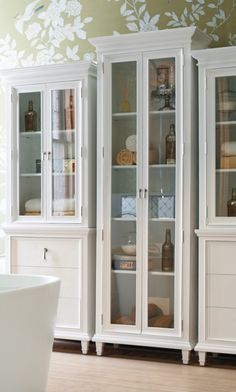 Inspired by architectural elements of stately London townhouses, our Sheffield Full Bath Cabinet is the epitome of master bath elegance. It features full-length glass front doors and a white lacquered finish for a clean, sophisticated look.