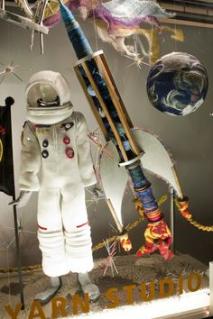 Knitted space suit in Lion Brand Yarn studio window....in New York