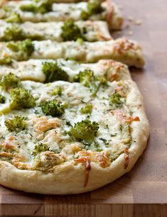 Broccoli Garlic Pizza  INGREDIENTS: 1 1lb. pizza dough, divided in half (I use pizza dough from the market) 1/3 cup extra virgin olive oil, plus 2 teaspoons 4 to 5 cloves garlic, finely minced 1 lb. broccoli florets 1/2 teaspoon kosher salt, divided 1/4 teaspoon freshly ground black pepper 1/8 cup pecorino romano cheese, finely grated 8 ounces mozzarella cheese, grated 1/8 cup fresh parsley, chopped