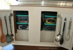 Pop Up Camper Remodel:  Adding More Storage.  We enclosed the wheel well to add a shelf.  Command hooks on the cabinet doors provided the perfect cooking utensil storage.
