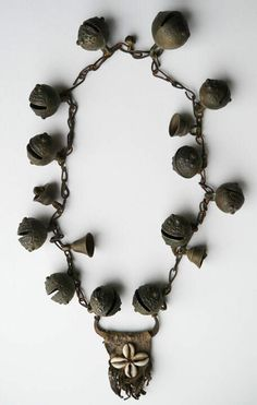 This shaman's bell necklace measures          approximately 100 cm (39 inches) end to end, and features 17 bells; 12 of which are wonderfully detailed bronze tiger bells and 4 small brass shrine bells plus a tiny bronze charm bell.