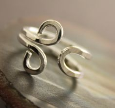 Om hand forged adjustable sterling silver ring - Size 5 - 12. $37.00, via Etsy.