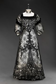 Dress c. 1905 - elaborate black embroidered netting over white gown - Museum of Decorative Arts, Prague