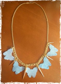 Butterfly Rock Necklace.  Available at tooldage.flyingcart.com