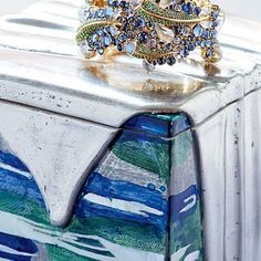 """""""Extraordinary"""" doesn't begin to describe the collaboration between Temple St. Clair Carr's jewelry designs when combined with a giftbox by Artist Nancy Lorenz.  Yes, please."""