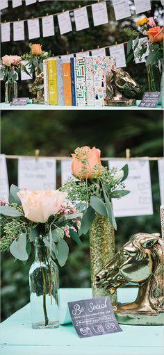 Classic book and floral decor wedding ideas. Captured By: Dear Wesleyann #weddingchicks http://www.weddingchicks.com/2014/06/19/colorful-florida-panhandle-wedding/