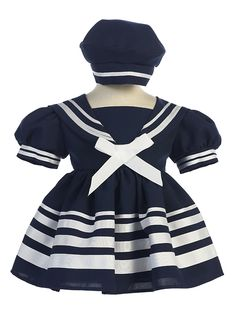 This girls navy sailor dress features a striped skirt and matching sailor cap.  In sizes for newborn, infant, toddler and little girls through size 5 this traditionally adorable girls sailor dress in navy blue is impossible to pass up!  Great for weddings, cruise trips, photos and more.