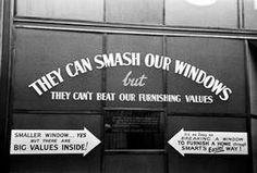 "G.B. ENGLAND. London. Oxford Street. World War II. The Blitz. A furniture stoe defiantly announces ""They can smash our windows but they can't beat our furnishing values"". 1940"