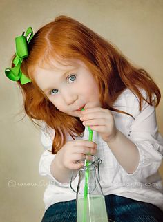 love the red hair with the green and the old-fashioned bottle