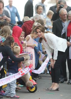 Kate could be seen animatedly chatting to the scores of well-wishers and children who had ...