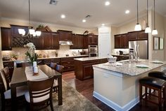 An open eating area complements this spacious kitchen. The Cameron model from Pulte Homes. The Preserve at Corkscrew community. Estero, FL.