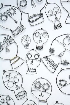 Wire skulls! Wouldn't it be amazing to have a screen made of these? Or spray paint them over a piece of fabric.