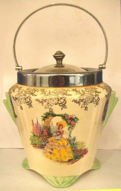 A VINTAGE ART DECO ERA WEATHERBY / FALCON WARE CRINOLINE LADY BISCUIT BARREL