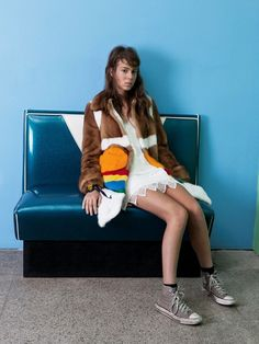 Soledad wears panelled fur coat by Prada; crochet dress by Guess; trainers by Converse; socks by Falke