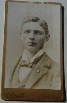 """ATLANTA PHOTOGRAPHER, C.W. MOTES, 34 WHITEHALL ST., ATLANTA, GA. CARTE DE VISITE (CDV) OF AN EMORY COLLEGE STUDENT GRADUATE, CLASS OF 1895. SIGNED ON THE BACK BY """"A.C. BELCHER, YOUR FRIEND AND CLASSMATE"""". A.T.O. FRATERNITY LAPEL PIN. From the J. Fred Rodriguez Atlanta Collection."""