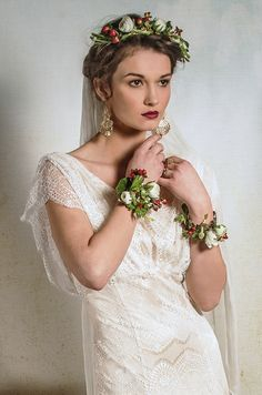 Introducing The New Bridal Capsule Collection From Belle & Bunty - http://www.belleandbunty.co.uk/  Bride wears flowers in her hair and floral wrist corsage.