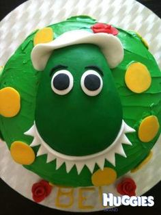 D-O-R-O-T-H-Y, Dorothy the Dinosaur!  Chocolate mud cake with butter icing, fondant Dorothy, and chocolate spots.