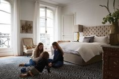 At home with the creative director of French fashion house Chloé : The children in the master bedroom, with terrace overlooking Paris.