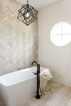 Master bath sanctuary with herringbone marble tile accent wall and Kelly Wearstler chandelier. Interior design and specifications by boutique Orange Country design firm, Sérendipité. photo credit: Melissa Brandman Wallpaper Accent Wall Bathroom, Tile Accent Wall, Green Accent Walls, Stone Accent Walls, Bathroom Accents, Accent Walls In Living Room, Accent Wall Bedroom, Living Room Grey, Wall Wallpaper