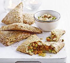 Sweet potato & pea puffs. These samosa-like puff pastry parcels filled with a spiced vegetarian mix are perfect for the freezer, so try making a batch