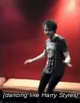 Michael Clifford dancing like Harry Styles.