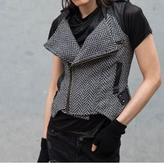 Herringbone Lux Tweed Fashionable Sweater Vest S This aweasome #herringbone vest is black and white with a zip front. Leatherette details with studs accenting on the sides and shoulders and back! Really cool! And has a quality look and feel. Lined inner. By #DanielRainn Size: Small (will fit larger). ✅✅Offers Considered✅✅ #vintage #edgy #style #fashion #unisex #lux #nordstrom #houndstooth Daniel Rainn Jackets & Coats Vests